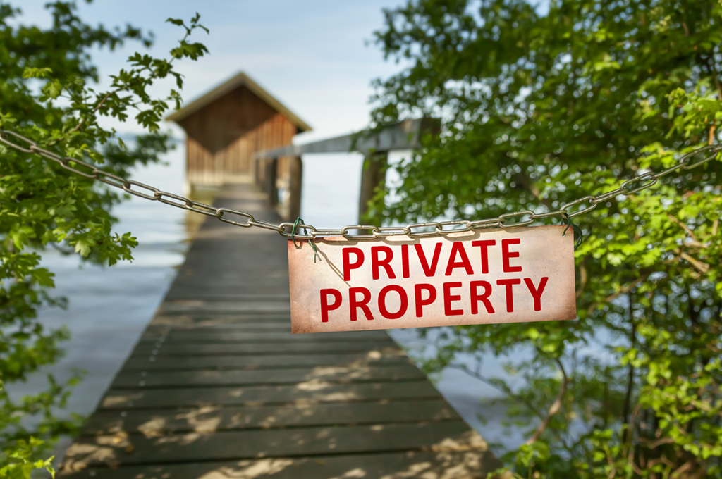 Image of a private property sign blocking an entrance.