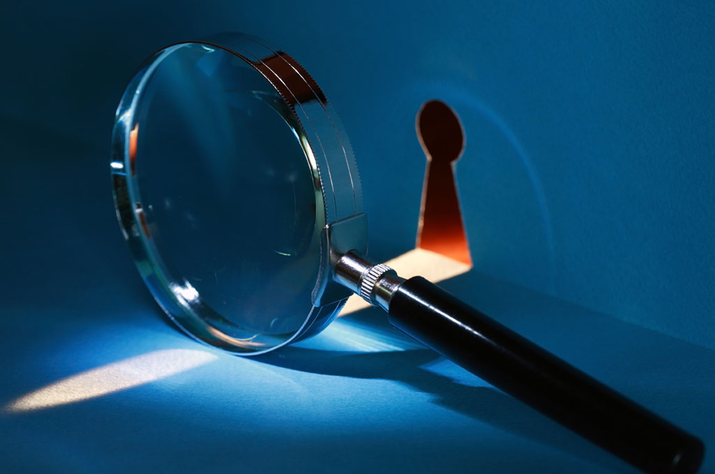 Image of a magnifying glass next to a key hole